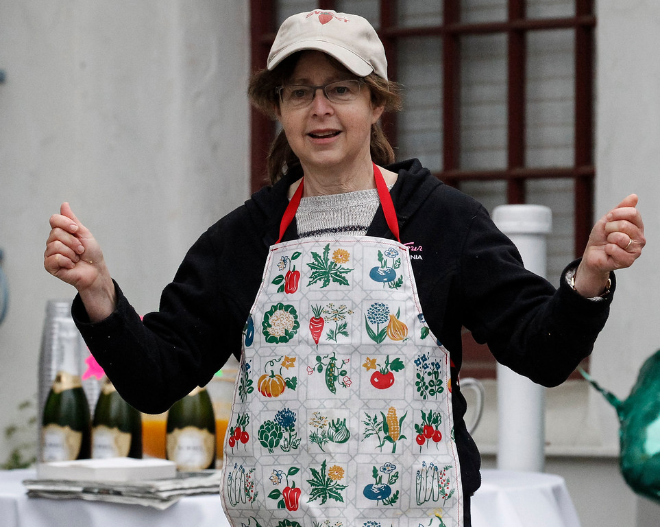 """. \""""Strawberry Lady\"""" Dasha Keig gestures as she volunteers across from the strawberry station during the 2016 Big Sur International Marathon on Sunday, April 24, 2016 in Carmel, Calif. (Vernon McKnight/Herald Correspondent)"""