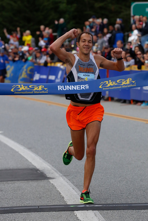 . Adam Roach of Pebble Beach celebrates as he crosses the finish line to win the 2016 Big Sur International Marathon with a time of 2:35:36 on Sunday, April 24, 2016 in Carmel, Calif. (Vernon McKnight/Herald Correspondent)
