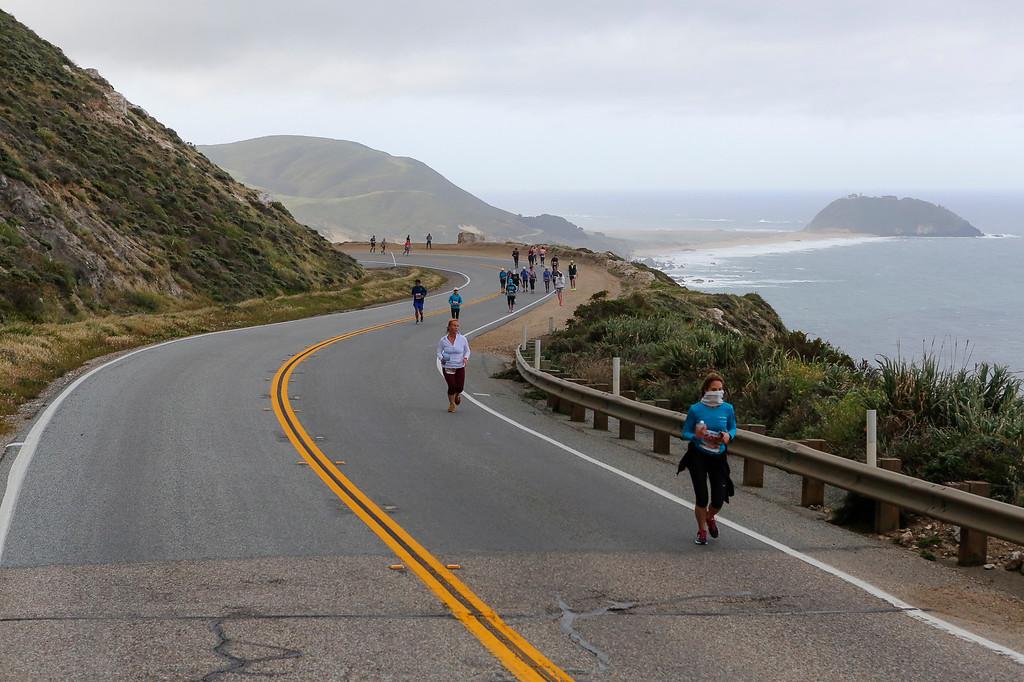 . Runners make their way down Highway 1 towards Carmel during the 2016 Big Sur International Marathon on Sunday, April 24, 2016 in Big Sur, Calif. (Vernon McKnight/Herald Correspondent)