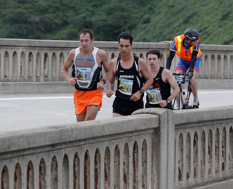 . Elite men runners, including Adam Roach of San Jose, left, run across Bixby Bridge during the 2016 Big Sur International Marathon on Sunday, April 24, 2016 in Big Sur, Calif. (Vernon McKnight/Herald Correspondent)