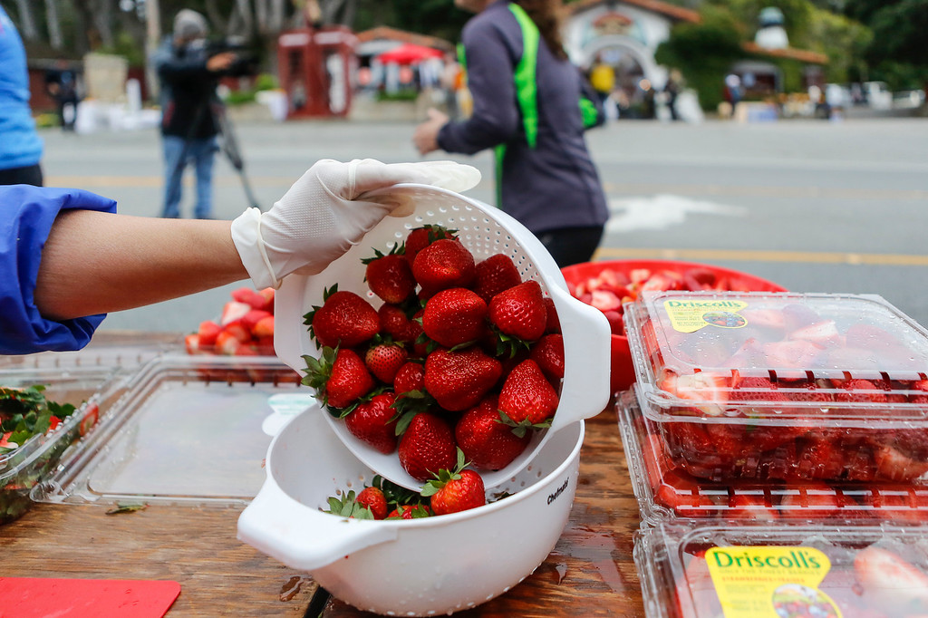 . Fresh strawberries are prepared for marathon runners during the 2016 Big Sur International Marathon on Sunday, April 24, 2016 in Big Sur and Carmel, Calif. (Vernon McKnight/Herald Correspondent)