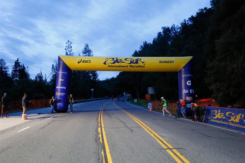 . Workers setup the starting line before the start of the 2016 Big Sur International Marathon on Sunday, April 24, 2016 in Big Sur, Calif. (Vernon McKnight/Herald Correspondent)