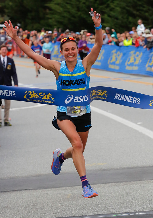 . Magdalena Boulet of Oakland celebrates as she crosses the finish line to win the 2016 Big Sur International Marathon with a time of 3:01:27 on Sunday, April 24, 2016 in Carmel, Calif. (Vernon McKnight/Herald Correspondent)
