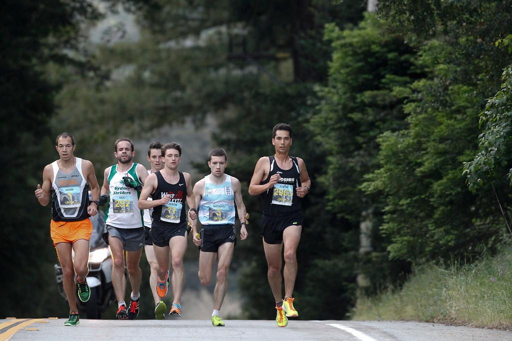 . Elite men runners, including Adam Roach of San Jose, left, run down Highway 1 during the 2016 Big Sur International Marathon on Sunday, April 24, 2016 in Big Sur, Calif. (Vernon McKnight/Herald Correspondent)
