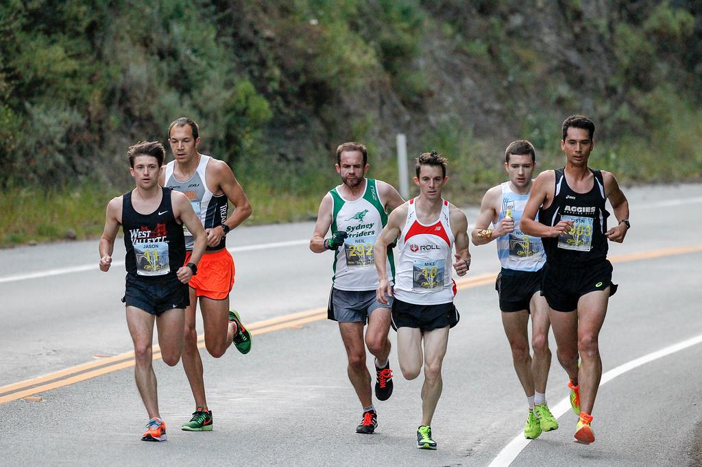 . Elite men runners, including Adam Roach of San Jose, center, run down Highway 1 during the 2016 Big Sur International Marathon on Sunday, April 24, 2016 in Big Sur, Calif. (Vernon McKnight/Herald Correspondent)