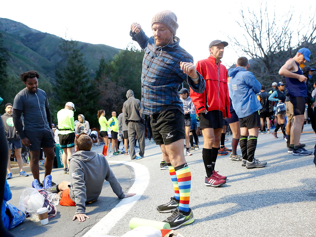 . Charles Blacker of England warms up in rainbow sox before the start of the Big Sur Marathon in Big Sur, Calif. on Sunday April 29, 2018. (David Royal/ Herald Correspondent)