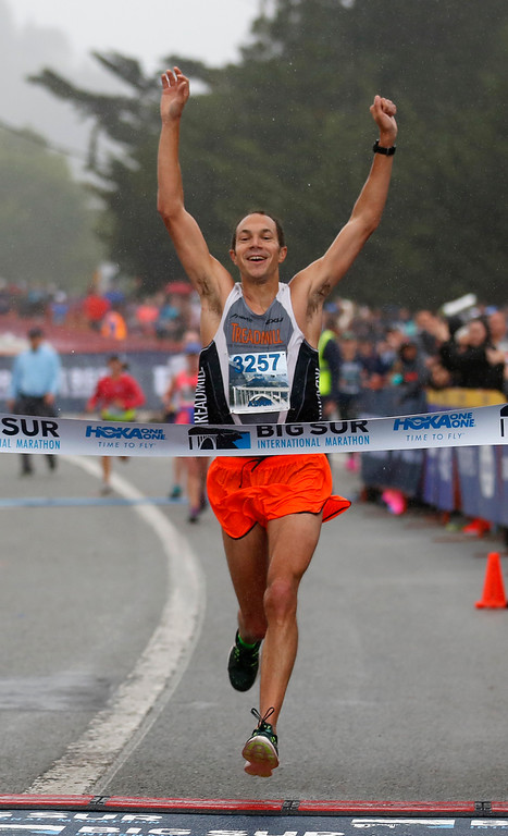 . Adam Roach of Pebble Beach crosses the finish line to win the mens title during the Big Sur Marathon in Carmel, Calif. on Sunday April 29, 2018. (David Royal/ Herald Correspondent)