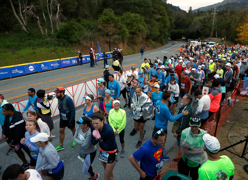 . Runnels funnel in to the starting line before the start of the Big Sur Marathon in Big Sur, Calif. on Sunday April 29, 2018. (David Royal/ Herald Correspondent)