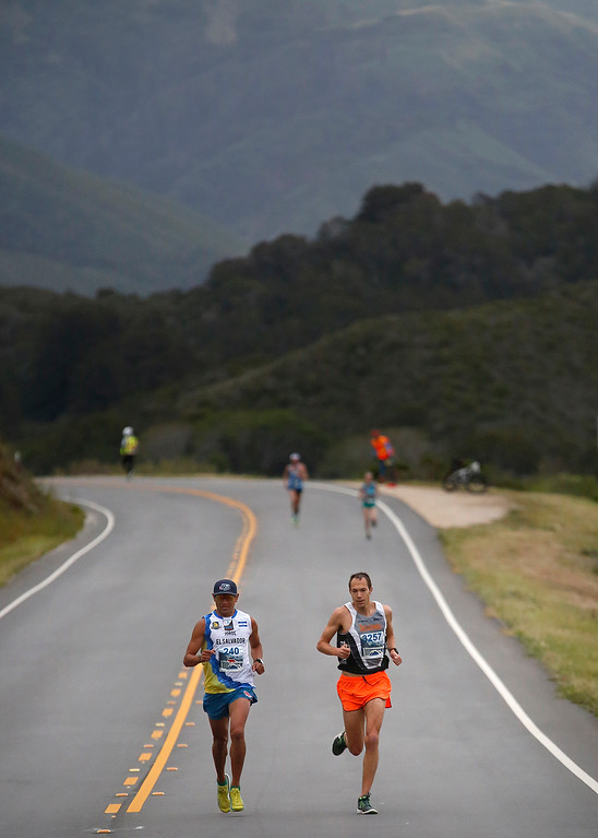 . Jorge Maravilla of Mill Valley, left, and Adam Roach, of Pebble Beach run past Andrew Molera State Park during the Big Sur Marathon in Big Sur, Calif. on Sunday April 29, 2018. Roach won the race, Maravilla took second. (David Royal/ Herald Correspondent)