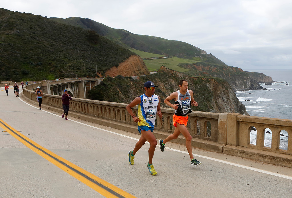 . Jorge Maravilla of Mill Valley, left, and Adam Roach, of Pebble Beach run over Bixby Bridge during the Big Sur Marathon in Big Sur, Calif. on Sunday April 29, 2018. Roach won the race, Maravilla took second. (David Royal/ Herald Correspondent)