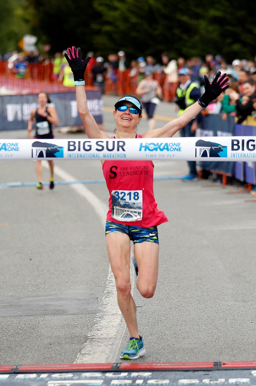 . Julia Rhie of Chapl Hill N.C. crosses the finish line to win the during the Big Sur Marathon in Carmel, Calif. on Sunday April 29, 2018. (David Royal/ Herald Correspondent)