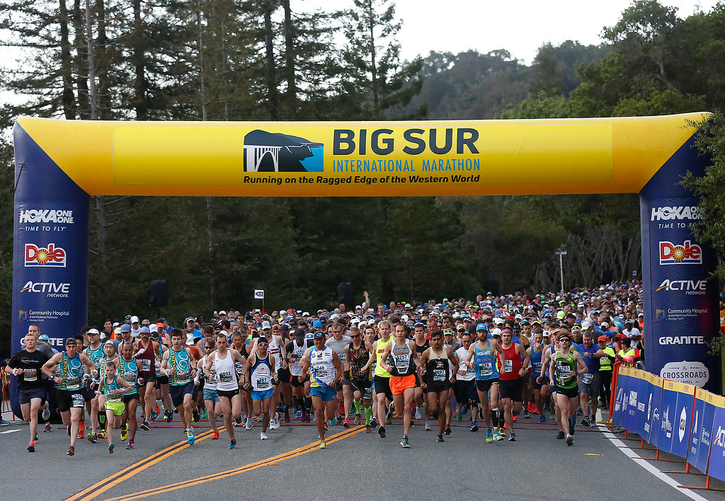 . Runners take off at the start of the Big Sur Marathon in Big Sur, Calif. on Sunday April 29, 2018. Eventual winner Adam Roach is in orange shorts. (David Royal/ Herald Correspondent)