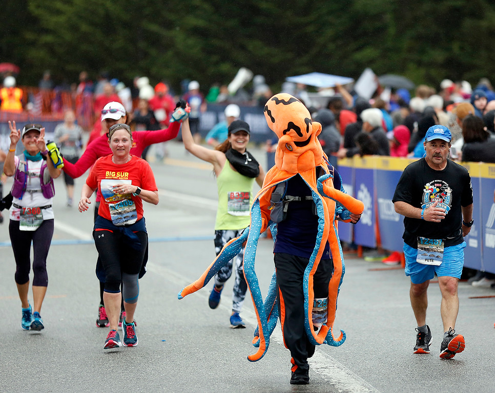 . A person in an octopus costume runs toward the finish line during the Big Sur Marathon in Carmel, Calif. on Sunday April 29, 2018. (David Royal/ Herald Correspondent)