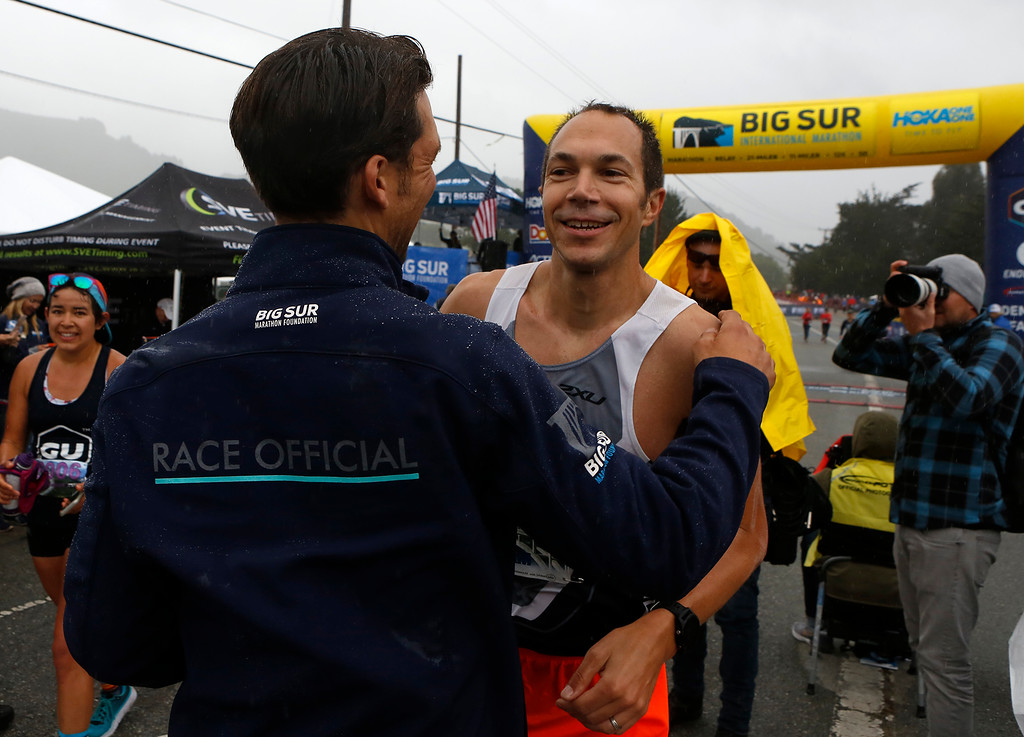 . Adam Roach, of Pebble Beach is embraced by his friend Ben Balester after Roach won the Big Sur Marathon in Carmel, Calif. on Sunday April 29, 2018. (David Royal/ Herald Correspondent)