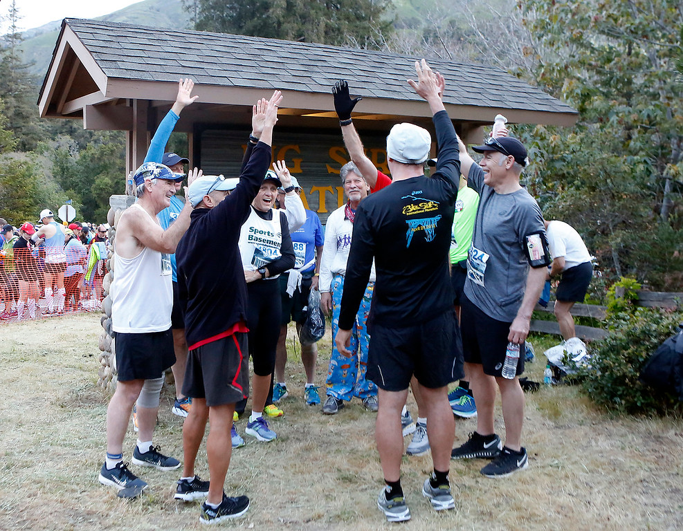 . Members of the Grizzled Vets who have run all 33 Big Sur Marathons gather up for a cheer before the start of the race in Big Sur, Calif. on Sunday April 29, 2018. (David Royal/ Herald Correspondent)
