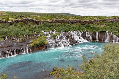 Hraunfossar Waterfall - water coming out of Lava Layers, not a river