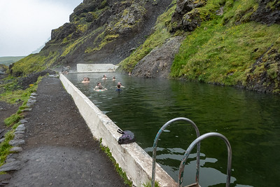 Seljavallalaug Geothermal pool - Stef at far back next to rock wall
