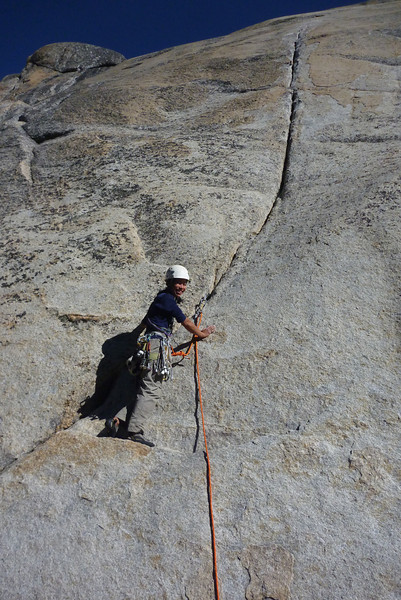 Enmoore launching up some 5.7 splitter finger crack at Toulumne Meadows, probably on Daff Dome