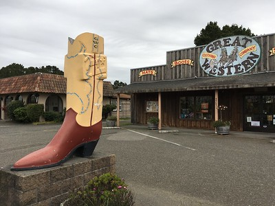 GIANT BOOT: Great Western Clothing Company on Broadway in Eureka has some big shoes to fill. The boot, around Christmas time, is decorated to look like Santa's boot. (Ruth Schneider - The Times-Standard)
