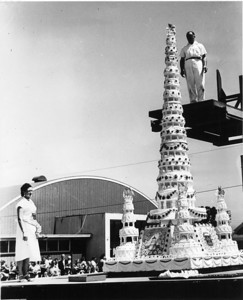 "GIANT CAKE: The ""World's Tallest Cake"" - at 15 1/2 feet tall - was constructed at the Humboldt County Fair in 1953.  It was baked by Ferndale baker Primo Marca and served to 10,500 visitors to the fair on Aug. 16, 1953. To bake the cake, Marca used 500 pounds of flour, 600 pounds of sugar and 3,000 eggs among other ingredients. (Photo contributed by Ferndale Museum)"