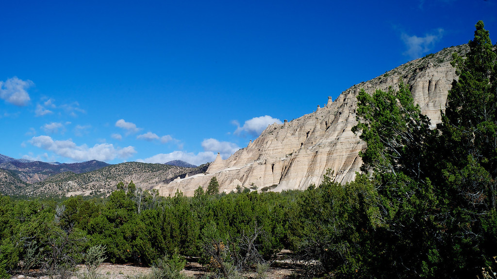 Kasha-Katuwe Tent Rocks National Monument<br />                      October 2011<br /> <br /> Just south of Santa Fe, NM is one of the most unusual canyons in the country.  As you will see, some of the areas look like sets from the Star Wars movies.  We arrived at the park early and for nearly all of our hike through the canyon were the only visitors in the canyon.  The first image is the view from the parking lot at the trail head and it only provides a glimpse of the unique area you are about to enter.<br /> <br /> There are two trails, a canyon floor trail called the Cave Loop Trail, and a trail to the top called the Slot Canyon Trail.  We focused on the Slot Canyon Trail.
