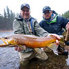 Bill Greiner holds up a glossy buck for his buddy, (and the angler), Phil Taub.  Photo: Eric Paulson