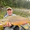 Skip Herman with a NZ brown of a lifetime, caught on 4x and a cicada! Photo by Zane Mirfin.