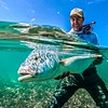 David Koepsel with one of many Trevally in the Seychelles. Photo by Cameron Musgraves.