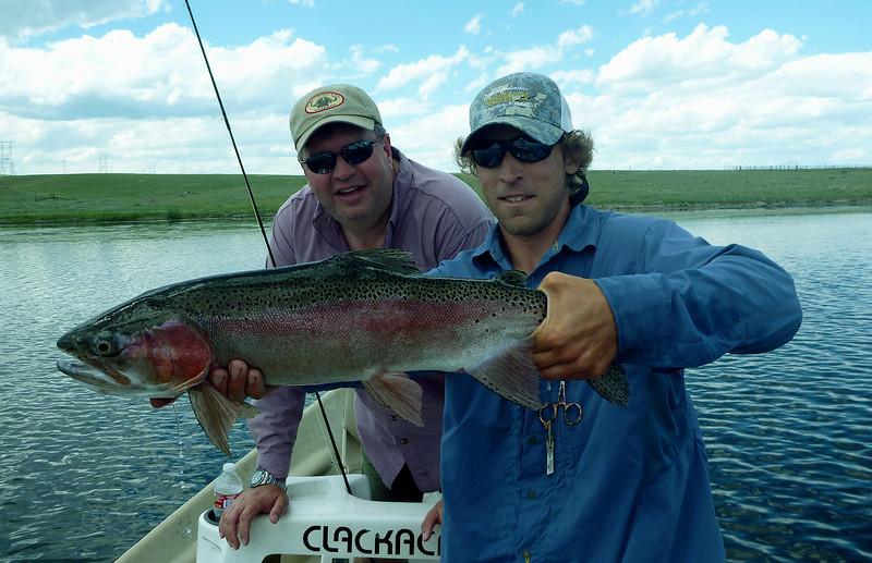 TJ Yarema and Guide Brian Sienkowski with a big private pond rainbow... Photo: Lisa Yarema