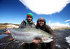 Julien and James with a strong fighting 22 pounder... Photo: Pollo