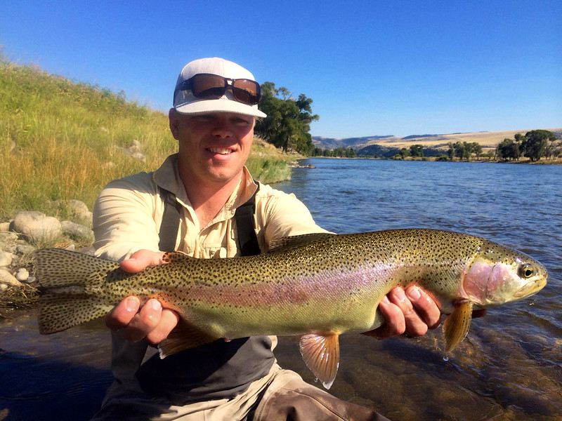 "Andrew Babcock with an impressive 23"" hopper eating rainbow! Photo: Randy Ferris"