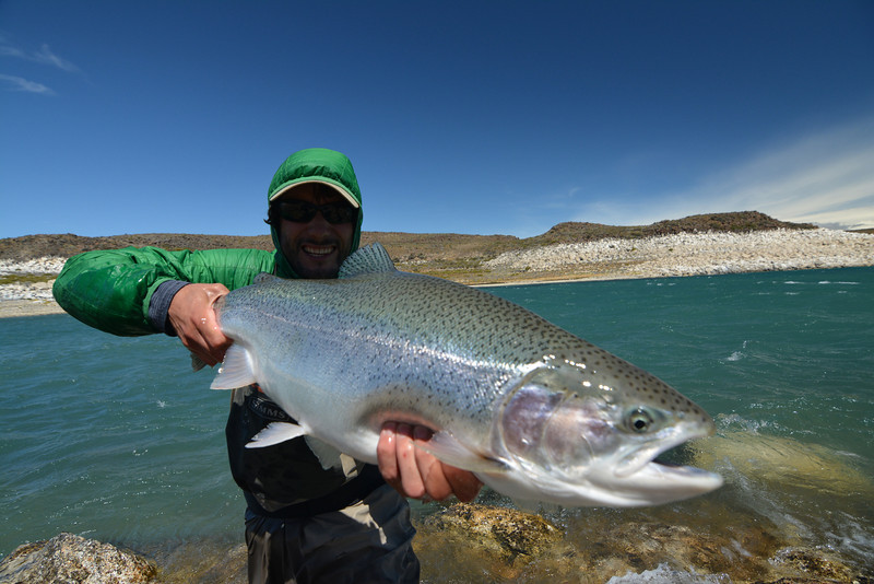 Guide Julien taking a break from the camera.  He caught this one on his 9'#5 weight Loop!<br /> Photo: James Anderson
