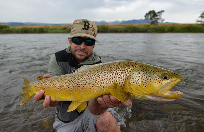 """Lars """"the axe man"""" Axelsen with a large and in charge Yellowstone brown.  Photo: James Anderson"""