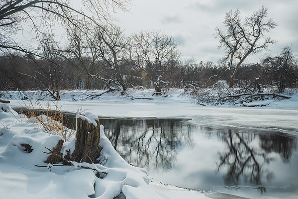 Snow Blanket over the Riverbank
