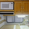 Microwave, range top closed, dish cabinet