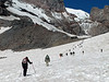 Line of hikers approaching Camp Muir.