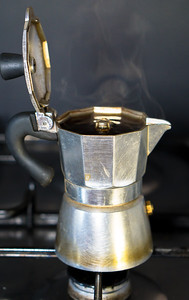 Moka On The Stove.italian Traditional Old Coffee Maker With Hot Espresso  Inside, Open A Coffee Pot,