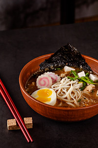Concept Of Asian Cuisine. Japanese Ramen Soup With Noodles, Egg, Tofu, Nori, In A Japanese Dish. Clo