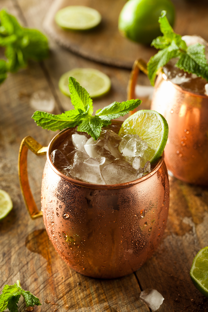 Moscow Mule one of the best cocktails around the world, served in a copper mug with mint leaves and lime.
