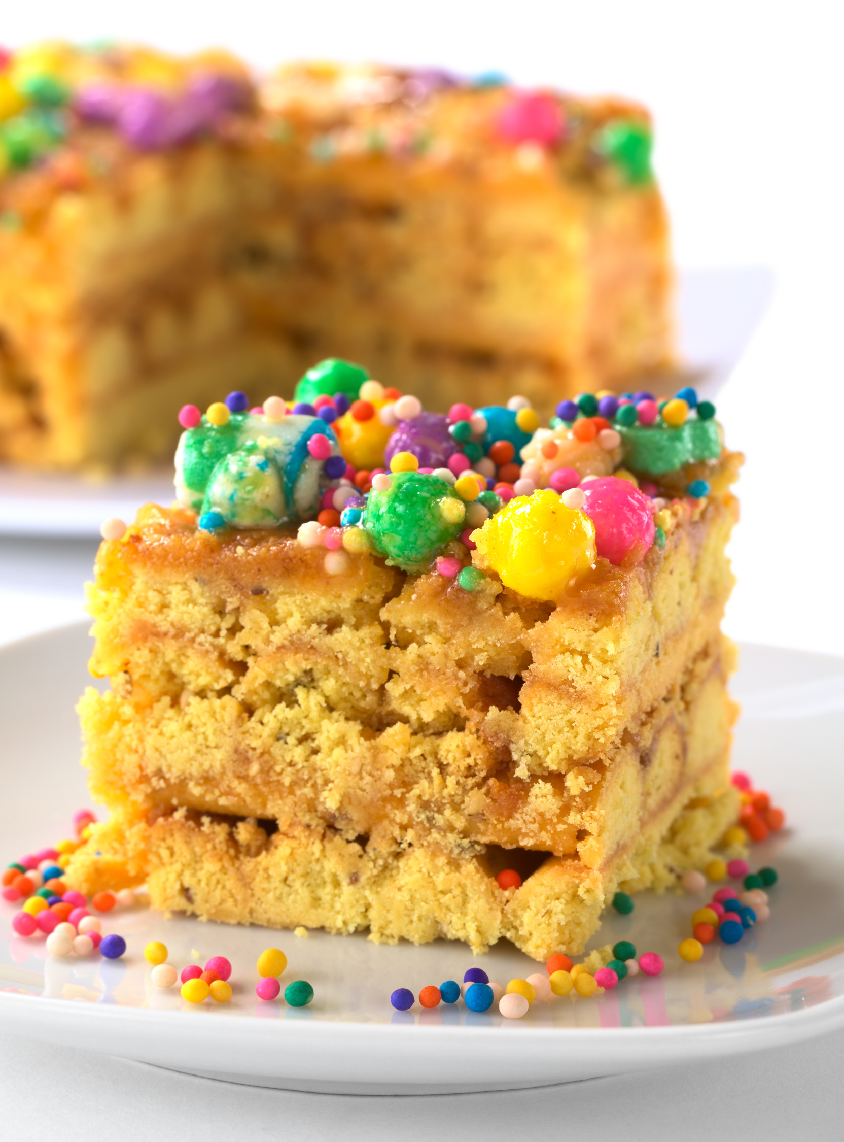 In Peru, a colorful cake called Turron flavored with anis sesame dried fruits and honey and garnished with colorful sweets on top