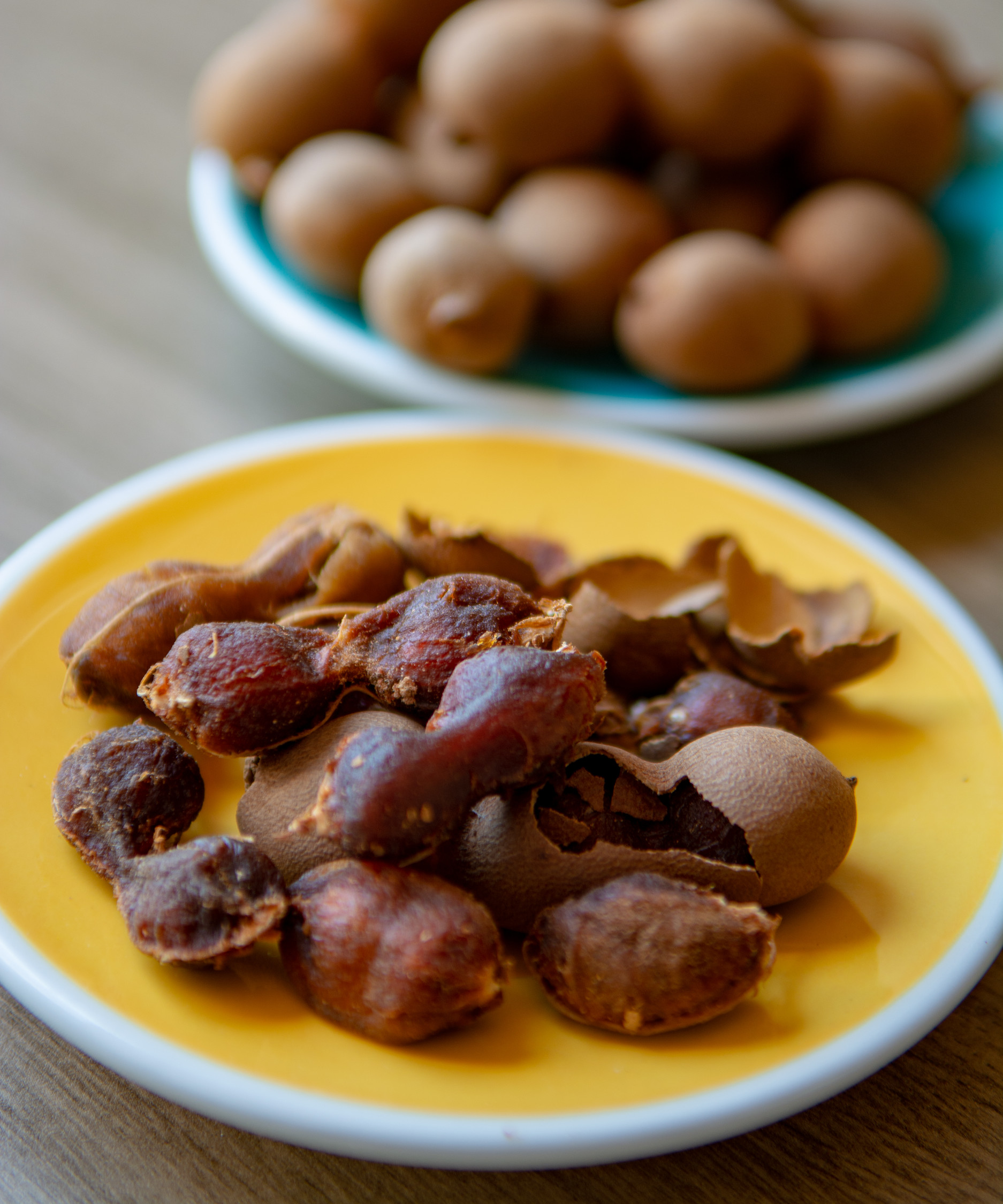 Plate of tamarind Cuban fruit on a yellow plate.