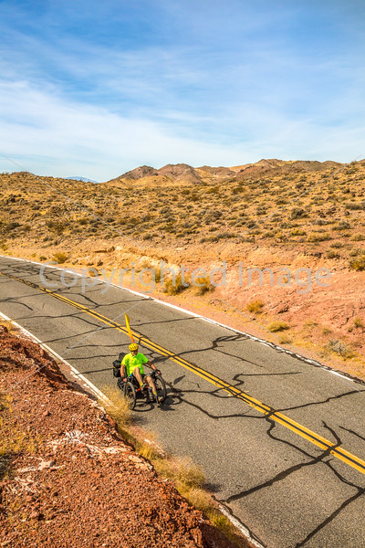 Cyclist near Salsbury Pass in Death Valley National Park, California - D5-C3-0056 - 72 ppi