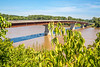 Cyclist on bridge over Missouri River at Hermann, Missouri - C3-0200 - 72 ppi