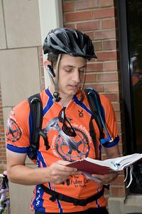 09 07  Ryan Iafigiola, leader of Bike Adventures, takes his turn doing morning devotions,  EV