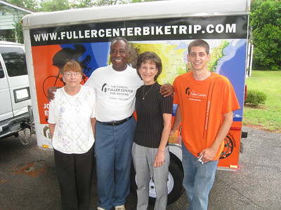 09 07-08 Fuller Center staff members Celia Loudermilk and Cathy Smith along with Jacob Batter, board member, take a photo op before ryan's departure. ff