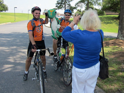 2010 07-23  Jackie Goodman of Atlanta takes a photo-op moment with two bikers showing off Geico's gecko.  ky