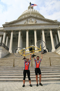 End of the road! Honeymooning cyclists Krystal Goodwin and Michael Tiemeyer raise their tandem bicycle in celebration at the steps of the U.S. Capitol building after completing the 3,600-mile Fuller Center Bicycle Adventure on Aug. 13. (Scott Umstattd photo)