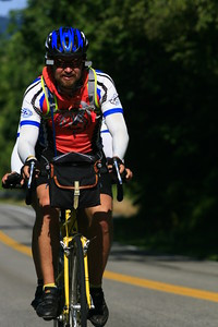 Michael Tiemeyer rides with wife Krystal Goodwin near the end of their cross-country journey with the Fuller Center Bicycle Adventure near Leesburg, Va., on Aug. 12. (Scott Umstattd photo)