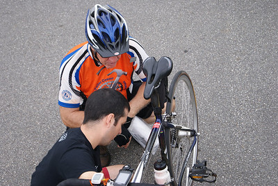 Tony Campbell gets bike work done at a rest stop.