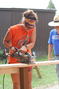 Lydia Huelskamp, the 2015 Fuller Center Bicycle Adventure volunteer leader, working during a 2014 build day.